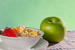 Closeup apple and fresh fruit with corn flakes Stock Photo