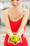 Closeup on apple in hand of young woman Royalty Free Stock Photography