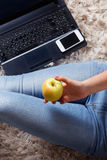 Closeup of an apple in a woman's hand Stock Photography