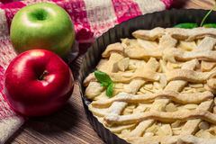 Closeup of apples and apple cake. Decorated with icing sugar Stock Photos