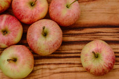 Closeup of apples on a wooden board Royalty Free Stock Image