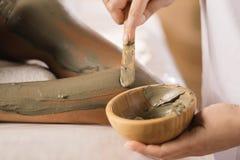 Closeup of applying mud mask. Stock Photos