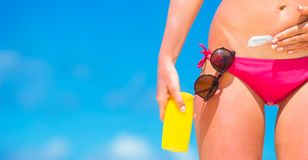 Closeup applying with sunscreen on white beach Royalty Free Stock Photography