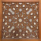 Closeup of arabesque ornaments of an old aged decorated wooden door Stock Photography