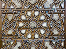 Closeup of arabesque ornaments of an old an aged decorated wooden door Royalty Free Stock Photos