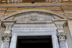 Closeup arch and columns of saint Peter basilica in Rome, Italy. Concept of catholic church interior and ancient landmarks and sightseeing Royalty Free Stock Images