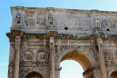 Closeup arch of Constantine in Rome, Italy. Concept of ancient landmarks and last minute cheap tours to Europe Royalty Free Stock Images