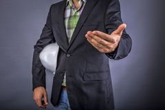 Closeup of an  architect man holding a hardhat under his arm whi Royalty Free Stock Photo