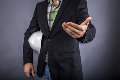 Closeup of an  architect man holding white hardhat under his arm Stock Images