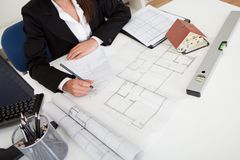 Closeup Of Architect Working On Blueprint Stock Photo