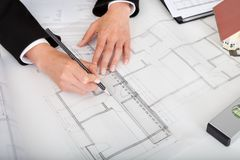 Closeup Of Architect Working On Blueprint Stock Images