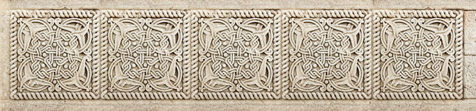 Closeup of architectural ornament. Stone carving of flower motif pattern Royalty Free Stock Photo