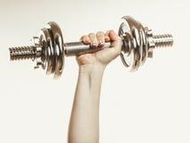 Closeup arm strong human lifting dumbbells weights Stock Images