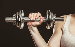Closeup arm strong woman lifting dumbbells weights Royalty Free Stock Photography