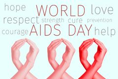 Red awareness ribbons and text world aids day stock photography