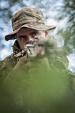 Closeup of army sniper. With automatic weapon Royalty Free Stock Image