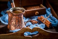 Closeup of aromatic coffee, old grinder and pot boiled coffee. On old wooden table royalty free stock image