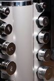 Closeup of arranged steel dumbbells as lifting objects Stock Image