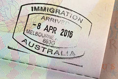 Closeup of Arrival entry stamp on passport for immigration trave Stock Photos