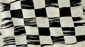 Racing flag. Closeup of art brush watercolor painting checkered black and white racing flag blown in the wind stock footage