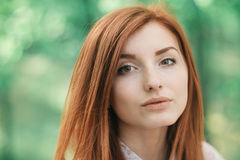 Closeup art portrait of a young redhead woman Royalty Free Stock Photography