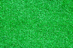 Closeup artificial green grass texture. Backgrounds Royalty Free Stock Photography