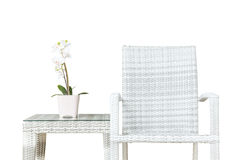 Free Closeup Artificial Plant With White Orchid Flower On Pink Flower Pot On Wood Weave Table With Wood Weave Chair Isolated On White Stock Images - 74016474
