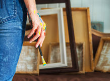 Closeup of an artist hand holding paintbrush Stock Images