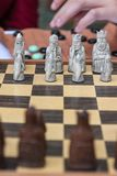 Closeup of Artistic Chess Pieces on Wooden Board Royalty Free Stock Images