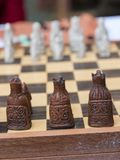 Closeup of Artistic Chess Pieces on Wooden Board Stock Image