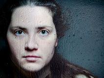 Closeup Artistic Portrait of Caucasian Woman Looking Through Woman Looking Through Glass with Water Drops and Tears Stock Photos