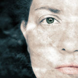 Closeup Artistic Portrait of Woman and with Smoke  Superimposed Over Her Face Royalty Free Stock Image