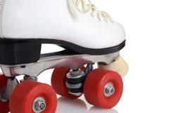 Closeup artistic women quad roller skates. On white Stock Photo