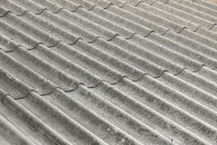 Closeup of asbestos roof pattern. In background Stock Photos
