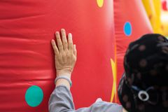 Closeup Asia old woman hands placing on big red air balloon royalty free stock photography