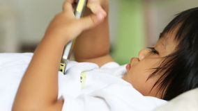 Closeup of asian baby play mobile phone Royalty Free Stock Image