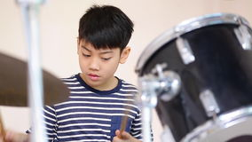 Closeup of asian child drummer practicing for a performance stock video