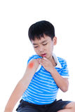 Closeup of asian child injured at shoulder. Isolated on white ba. Closeup of asian child injured at shoulder. Sad boy groaning and looking at bruise with a royalty free stock image