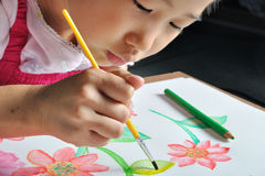 Closeup asian girl hand  paint with her watercolor pictur Royalty Free Stock Photo