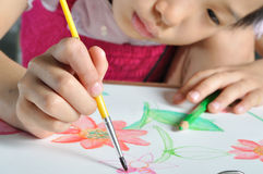 Closeup asian girl hand  paint with her watercolor pictur Royalty Free Stock Image