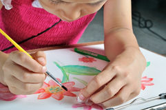 Closeup asian girl hand paint with her watercolor picture Stock Photo