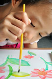 Closeup asian girl hand paint with her watercolor picture Royalty Free Stock Photos