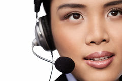 Closeup of an Asian lady wearing a headset Royalty Free Stock Photo