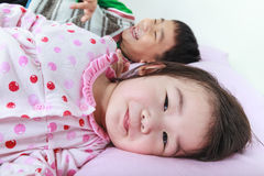 Closeup asian siblings having happy together in bed before sleep Royalty Free Stock Photos