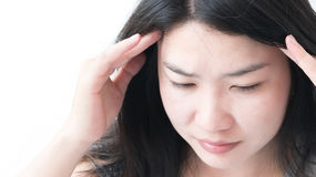 Closeup asian woman having headache with whitebackground. Royalty Free Stock Images