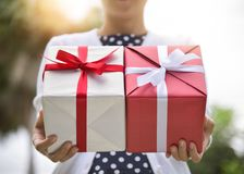 Asian woman holding gift boxes. Stock Image