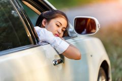 Closeup asian women of a worried car looking at side through the window in a sad day royalty free stock photos