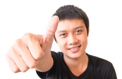 Closeup asian young man showing thumbs up with white background, Royalty Free Stock Photos