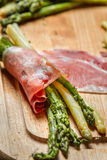 Closeup of asparagus and prosciutto royalty free stock photography