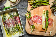 Closeup of asparagus rolled in ham and baked with cheese Royalty Free Stock Photos